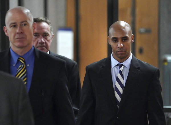 Former Minneapolis police officer Mohamed Noor, right, with attorneys Peter Wold, center, and Thomas Plunkett, left, walks out of the the Hennepin Cou
