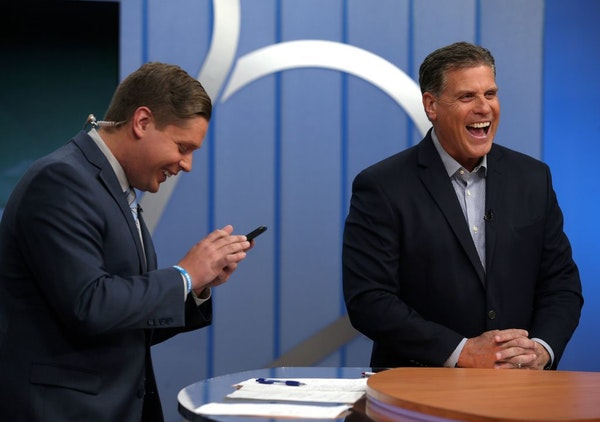 Randy Shaver, right, laughs next to his son, Ryan Shaver, during the Prep Sports Extra show at the KARE 11 studio in Minneapolis on Friday, Nov. 2, 20