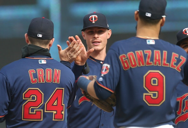 The Twins' Max Kepler celebrates Saturday's victory over Baltimore with teammates C.J. Cron and Marwin Gonzalez. All three homered in the game.
