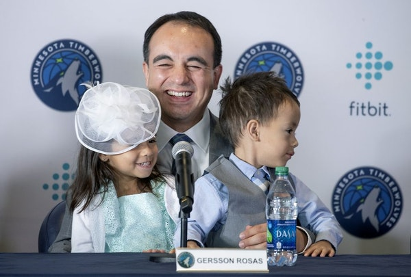 Minnesota Timberwolves new President of basketball operations Gersson Rosas laughed as his 3-year-old twins Giana, left, and Grayson took over the mic