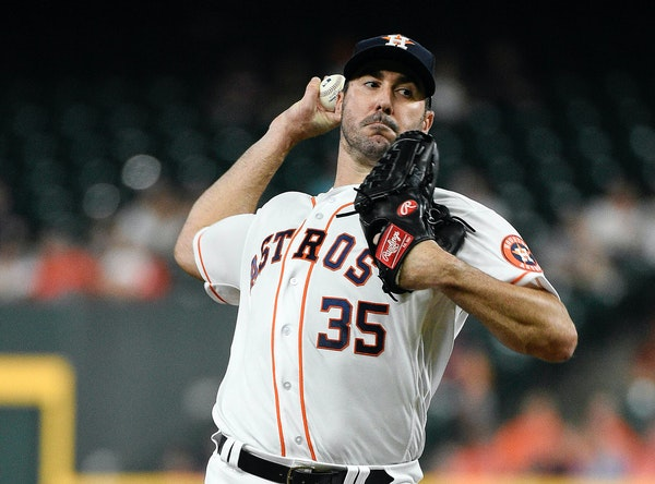 Astros starting pitcher Justin Verlander delivers during the first inning against the Twins