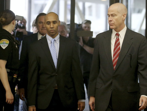 Former Minneapolis police officer Mohamed Noor walks through the skyway with his attorney Thomas Plunkett, right, on the way to court for the verdict