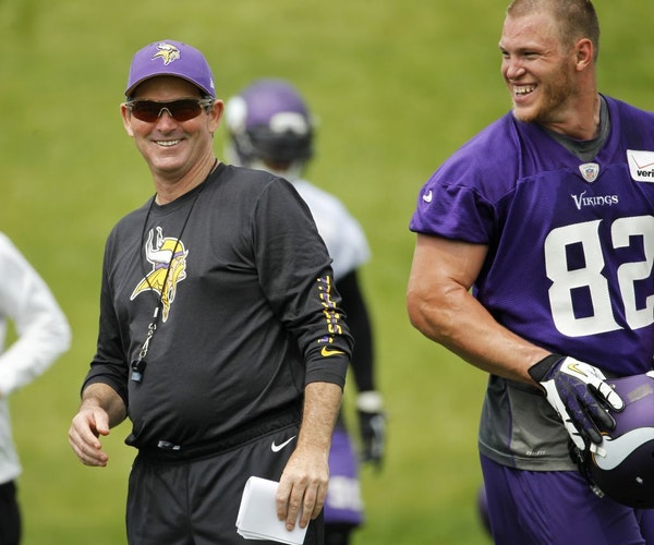 Minnesota Vikings head coach Mike Zimmer shares a laugh with tight end Kyle Rudolph (82) during an NFL organized training activity in Eden Prairie, Mi