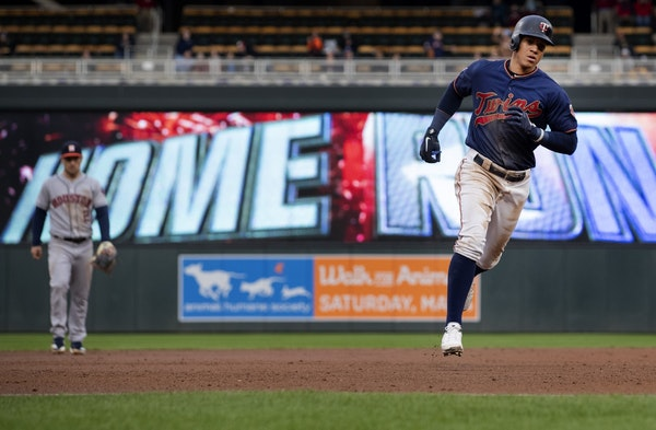 Minnesota Twins Ehire Adrianza rounded the bases after hitting a home run in the third inning.