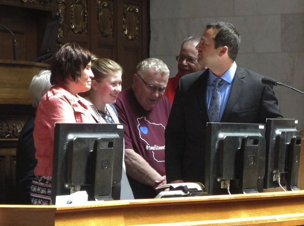 """Kidnapping victim Jayme Closs, second from left, appears with her family and supporters to receive a """"hometown hero"""" award from the Wisconsin Assembly"""