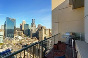 Views of downtown Minneapolis skyscrapers off the balcony.