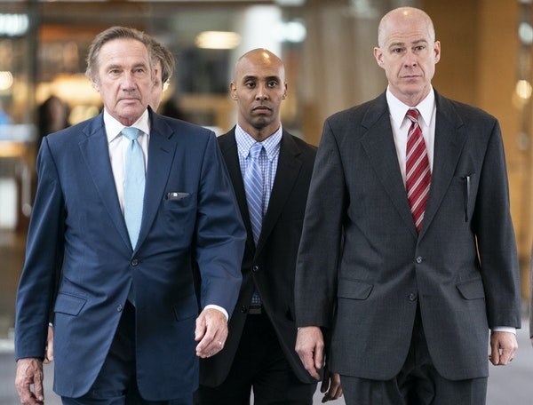 Former Minneapolis police officer Mohamed Noor, center, walked into the Hennepin County Courthouse for the verdict in the shooting death of Justine Ru
