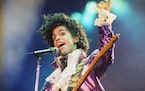 FILE - In this Feb. 18, 1985 file photo, Prince performs at the Forum in Inglewood, Calif. Prince's heirs have sued Walgreens and the Illinois hospita