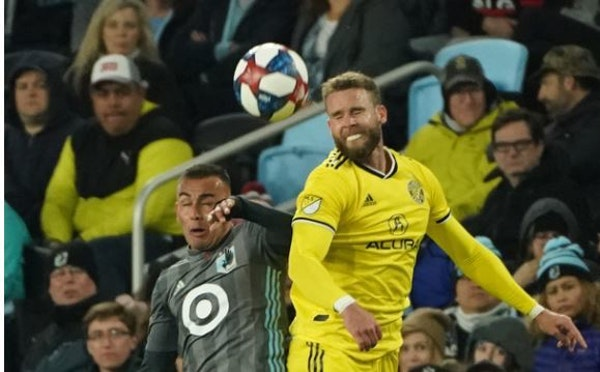 Minnesota United midfielder Miguel Ibarra (10) and Columbus Crew defender Josh Williams (3) jumped to head the ball in the second half.