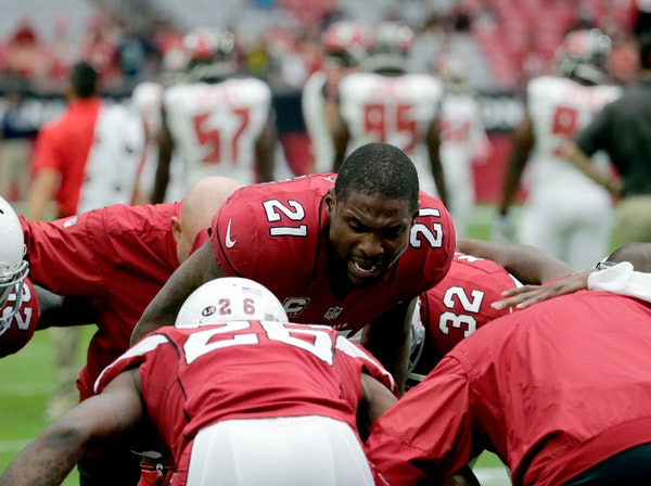 Arizona Cardinals cornerback Patrick Peterson (21) huddled with his teammates prior to the Sept. 18 game against Tampa Bay.
