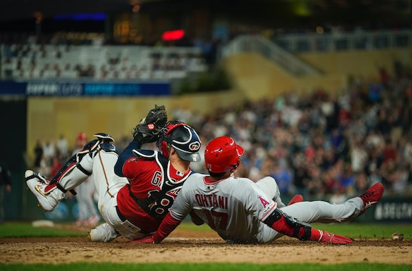 Twins catcher Mitch Garver was injured in a collision at home plate with the Angels' Shohei Ohtani in the eighth inning Tuesday night.