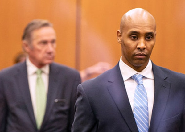 Former Minneapolis police officer Mohamed Noor walked through the elevator lobby of the Hennepin County Government Center with his legal team on Frida
