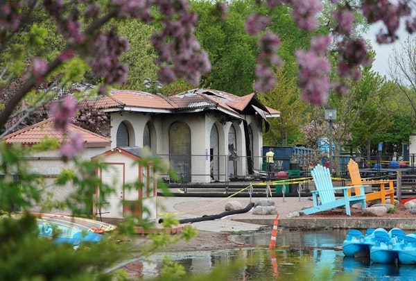 A day and a half after fire gutted the lakeside pavilion that housed Lola on the Lake, people still stopped to look at the destruction as inspectors c