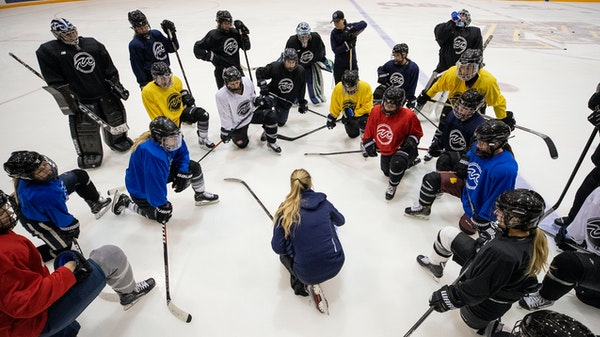 Minnesota Whitecaps co-head coach Ronda Engelhardt spoke to players during an early practice. The team won the NWHL title, but there are questions abo