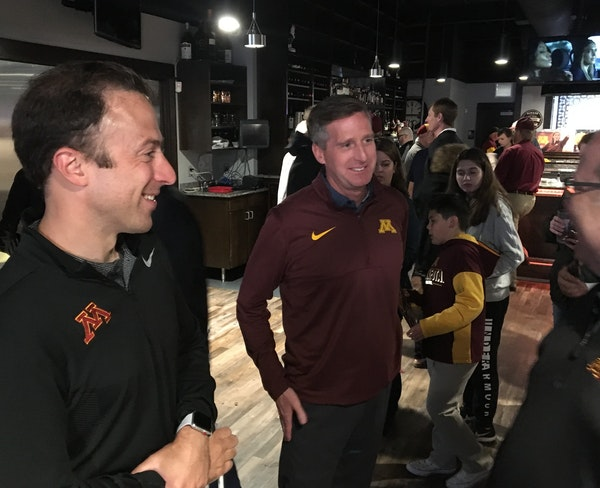 Men's basketball coach Richard Pitino, left, and athletic director Mark Coyle mixed and mingled with fans at the Gophers coaches caravan tour stop i