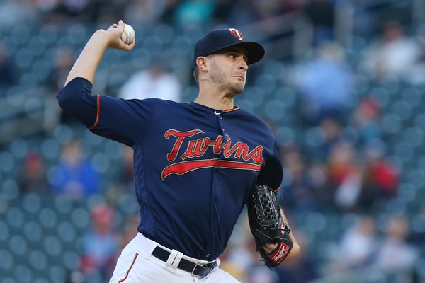 Twins pitcher Jake Odorizzi throws to a Detroit batter during the first inning