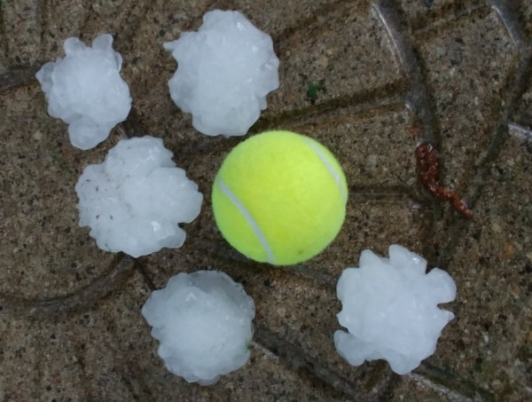 Photo courtesy of Dan Giesen: The National Weather Service in Chanhassen shared this photo of tennis-ball-sized hail during Tuesday night's storm. It