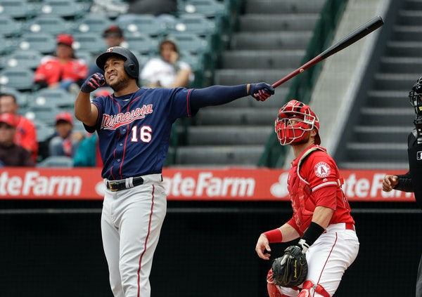 Jonathan Schoop follows the path of his three-run home run against the Los Angeles Angels during the second inning