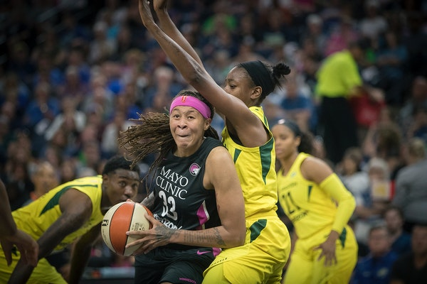 Lynx guard Seimone Augustus drove by Seattle's Jewell Loyd last August