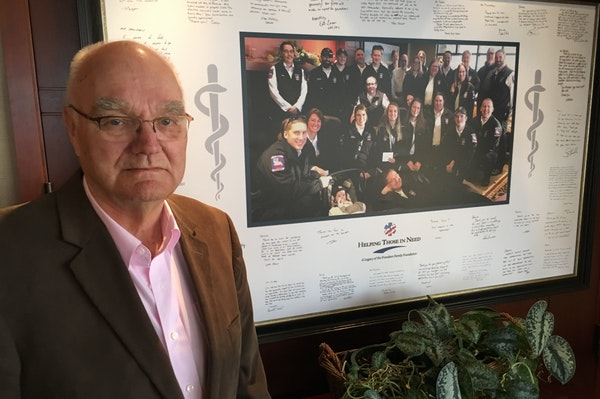 Dennis Frandsen has donated several million dollars to Lakes Region Emergency Medical Services in North Branch. He is seen with a signed photo of the