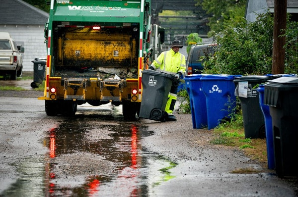 Waste Management worker Daniel Westerhaus collected trash from the alleys of the Snelling Hamline neighborhood of St. Paul's yellow zone on the first