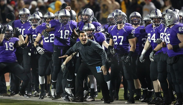 UST head coach Glen Caruso and the rest of the football team celebrated on the sideline as the clock ran out in December 2012.