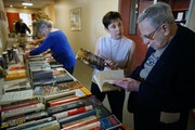 Robin White helped Stephen Spielberg, 84, browse through titles at Knollwood Place Apartments, courtesy of her nonprofit Green Books.