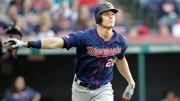 The Twins' Max Kepler watches a two-run home run off Cleveland starting pitcher Trevor Bauer in the third inning