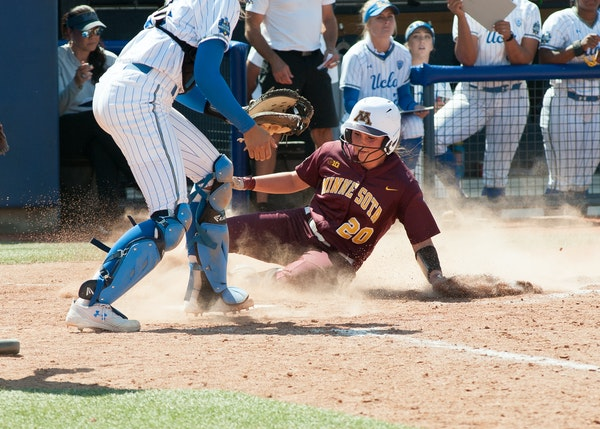 Maddie Houlihan slid into home vs. UCLA in the first game of the Women's College World Series but the Gophers could only get two runs in and lost the