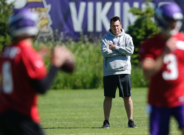 Minnesota Vikings assistant head coach and offensive advisor Gary Kubiak watches quarterbacks during drills at the team's NFL football training facili