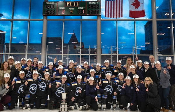Whitecaps players celebrated with the Isobel Cup after beating the Buffalo Beauts 2-1 in overtime for the NWHL championship on March 17 at TRIA Rink i