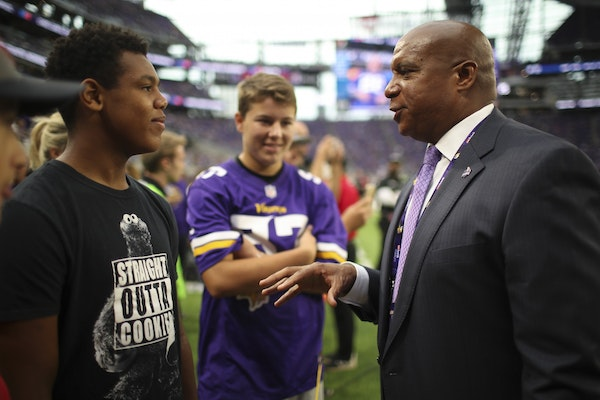 Kevin Warren with fans at a Vikings game in 2017.