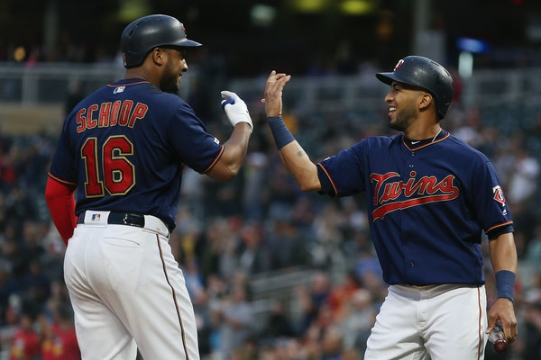 Jonathan Schoop, left, greets Eddie Rosario after they scored on Schoop's home run against the Mariners during the fourth inning