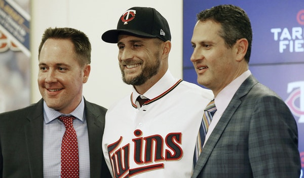 When the Twins' brain trust of Chief Baseball Officer Derek Falvey, left, and General Manager Thad Levine, right, introduced new manager Rocco Balde