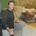 Jeff Muntifering stands by Nakili, a male black rhinoceros living at the Brookfield Zoo near Chicago.