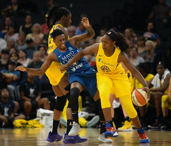 Los Angeles guard Chelsea Gray knocked Lynx guard Danielle Robinson into Chiney Ogwumike in the first half.