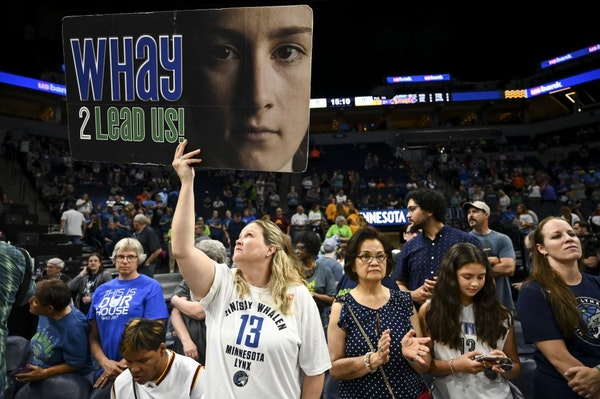 Amy Capitola, of Robbinsdale, held up a Lindsay Whalen sign before the start of Saturday's game against the Los Angeles Sparks. She's been a season ti