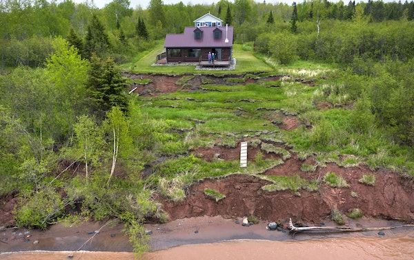 The shore has badly eroded in front of Mike and Kathy Briggs' log cabin on Lake Superior, so they chose to build a new structure farther back.
