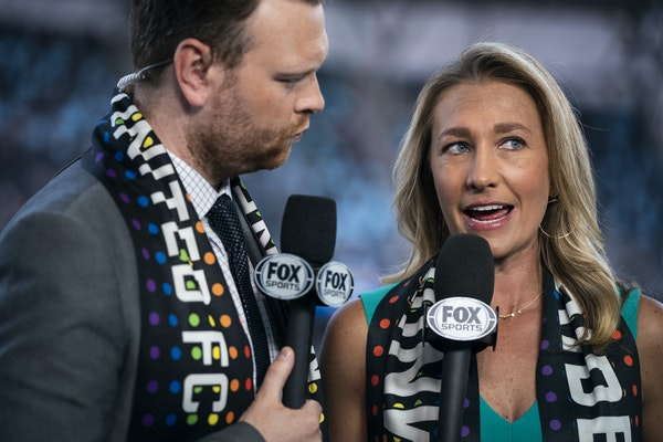 TV analyst Kyndra de St. Aubin, right, and play-by-play partner Callum Williams talk live during a pre-game broadcast before Minnesota United's matc