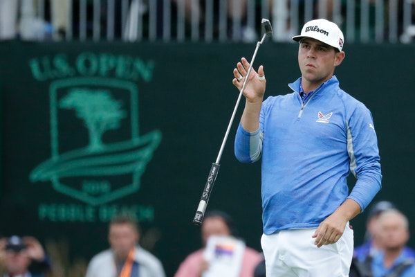 Gary Woodland reacted after missing a putt on the 18th hole during the third round, meaning he takes a one-shot lead into Sunday over Justin Rose.
