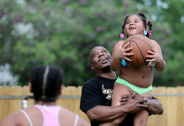 Dorsey Howard Jr., who moved into a home in Golden Valley two years ago, played basketball with his grandkids on Friday.