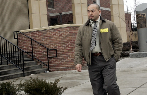 Former St. Paul police officer Tou Cha, walks out of the St. Paul Police department after resigning on Tuesday.