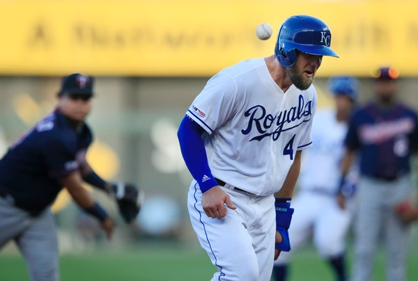 The Royals' Alex Gordon was hit in the helmet by a ball thrown by Twins third baseman Willians Astudillo during the first inning Thursday.