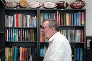 Outgoing U President Eric Kaler organized his books in his new office at Amundson Hall.