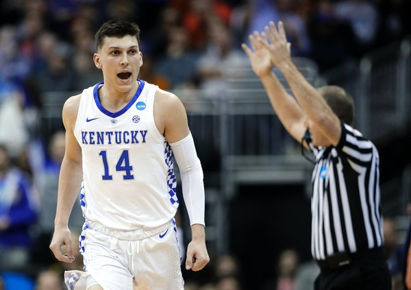Kentucky's Tyler Herro celebrates after making a 3-point basket against Auburn during the first half of the Midwest Regional final game in the NCAA me