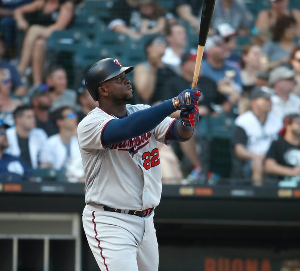 Miguel Sano watches his two-run home run during the eighth inning