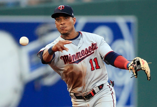 Minnesota Twins shortstop Jorge Polanco throws to first on a grounder by Kansas City Royals' Humberto Arteaga during the first inning of a baseball ga