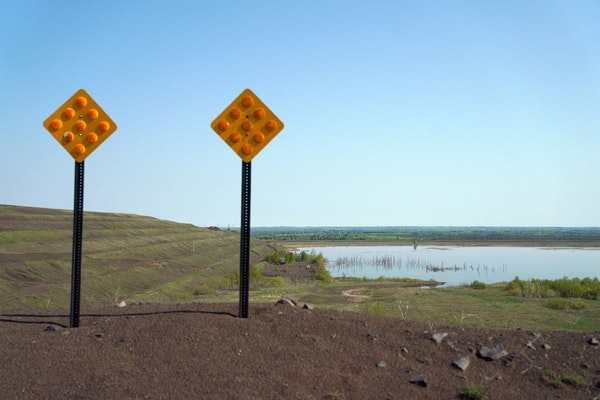 The Polymet tailings ponds could be seen over a small berm.