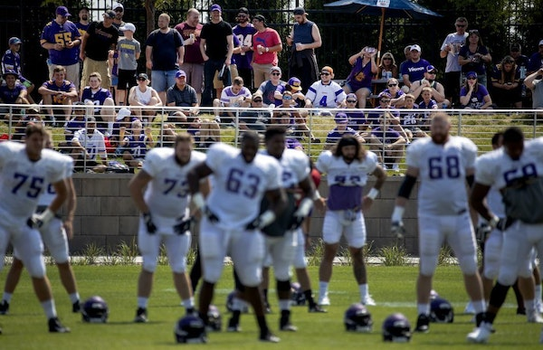 Fans watched the Vikings stretch before a training camp practice last season.