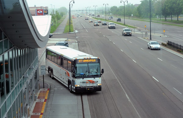 Commuters boarded a bus at the Apple Valley Transit Station south of County Road 42 on Cedar Avenue.